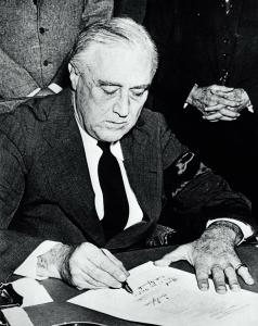 President Franklin D. Roosevelt signing the Declaration of War against Japan. 8 December 1941. National Archives and Records Administration, USA